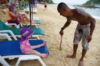 Getting VIP treatment at Nai Harn Beach, Phuket