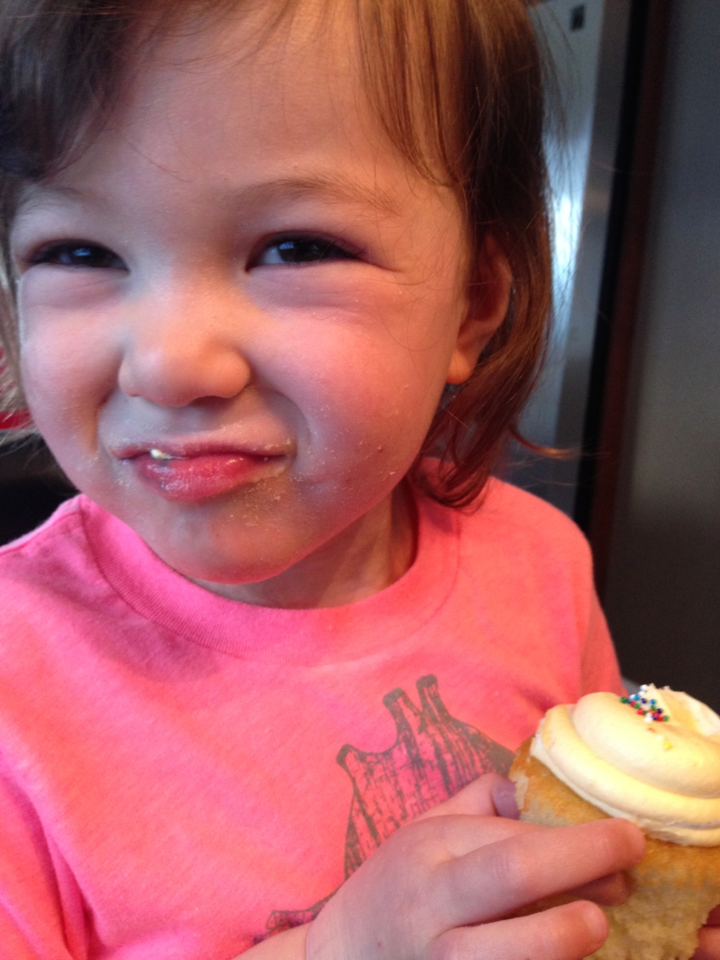Enjoying my post-biopsy cupcake treat!