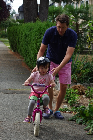 Teaching Addison how to ride a bike.